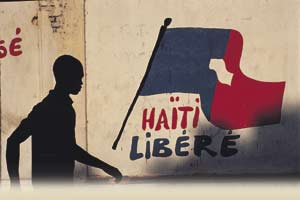 Flag of inconvenience - speaking out on the violence-plagued streets of Port-au-Prince.