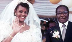 Tarnished reputation - Mugabe marries former secretary in 1996. Photographer unknown.