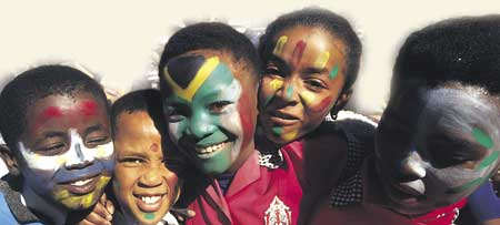 Painted flags and faces: Children's Commonwealth Day in Durban, South Africa.