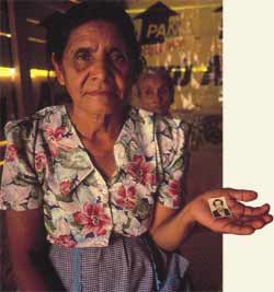 Keeping memory alive: the photograph is of her husband who disappeared in the massacre in Guatemala in the early 1980s.
