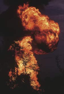 Blazing a trail. This fire in the Magurchara gas field, managed by the US-based transnational Unocal, caused extensive environmental damage but locals have received minimal compensation.