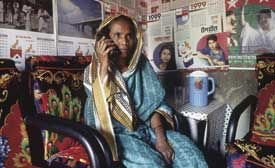 Hooked up to the world. The Grameen Phone initiative has taken mobiles into villages that have never had access to conventional telephones.