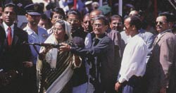 Laying aside the gun: Bangladeshi Prime Minister Sheikh Hasina and Shantu Narayan Larma after signing a peace deal in 1997.