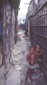 The poor meanwhile cannot escape slums like this one in the Agargoan district where Rimon once lived and where the rent per square metre is among the highest in the country.