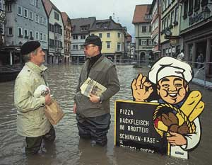 A mid-morning chat in the flooded streets of Wertheim am Main, Germany. Worldwide droughts and floods are a sign of climate meltdown.