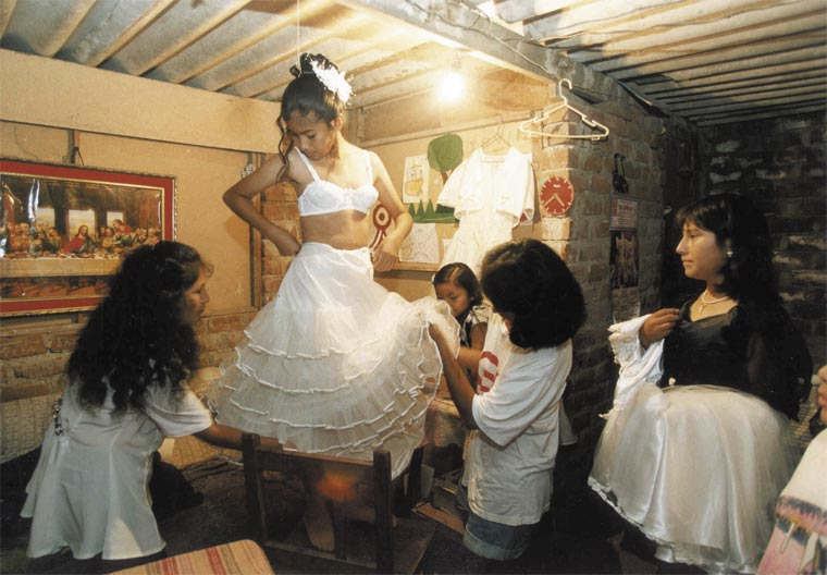 --A family in Lima prepare for their daughters sweet-fifeteen dance-- Photo © Susan Pastor Brizzolese