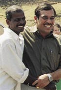 Vivek Pandit (right) receives a warm welcome from a freed farmer.