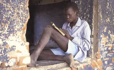 'Reading is one of the most radical things you can do,' argues Peter Whittaker. This Sudanese boy, displaced by war and oppression, sharpens his mind.
