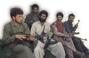 Mujahideen guerrillas in the mountains of Kashmir.