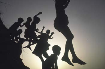 No fear of flying: children jumping into a pond in Bhuapur, Bangladesh.