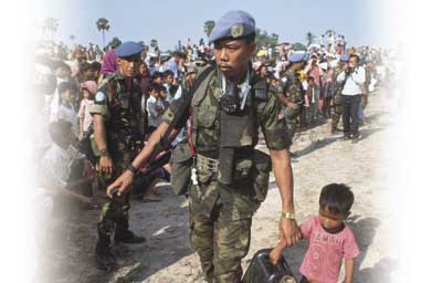 A helping hand: blue berets in action in Cambodia during one of the UN's more successful recent interventions.