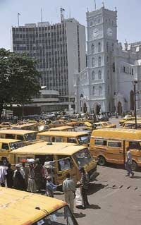 Molue and danfo drivers parked near Lagos Cathedral: they are world-record breakers for rudeness.