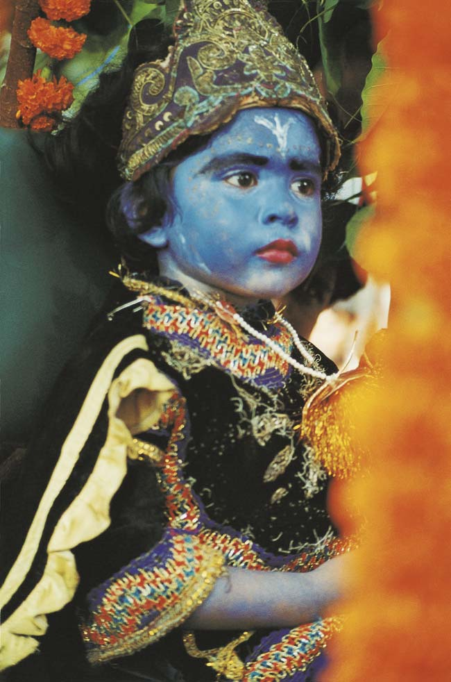 A child dressed up as Krishna. Bangladesh Photo © Monirul Alam / Drik.