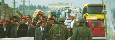 Checkpoint Kalandia – it can take hours to leave Jerusalem.