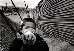 Boy rehydrates on the Mexican / US border.