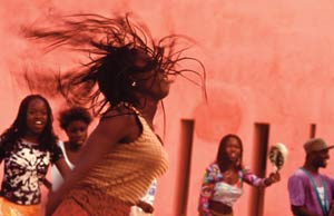 Bring on the future: women of Goree island, Senegal dance away from the island's slave-trade past.