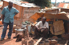 Reaping the Bush whirlwind: Mugambo sits in the wreckage of the business he has had for 20 years.