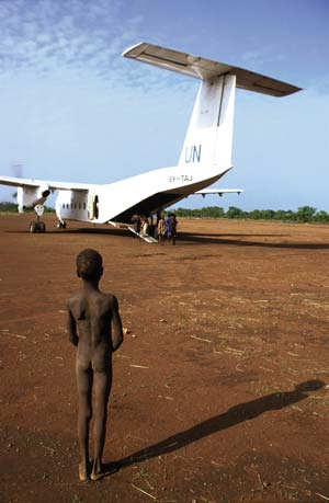 Planes operated by the UN routinely transport food to southern Sudan, where 19 years of civil war and government oppression have left an estimated 2 million people dead and 4.4 million people uprooted. Military offensives by the Sudanese Government and by rebels have intensified, with both sides attempting to gain ground before another round of peace negotiations. Photo: N Cooper / Exile Images