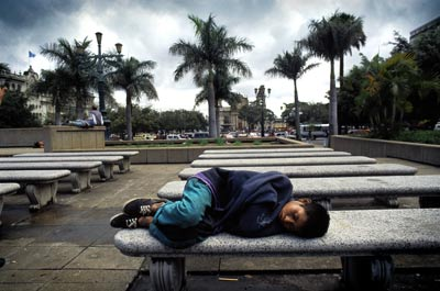 Sleeping rough in Guatemala City: Latin America's growing underclass are targets for paramilitary 'justice'. Photo: Martin Adler / Panos Pictures