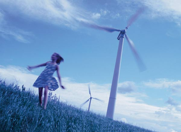 Girl and windmill Wind power is the fastest-growing energy source as concern about climate change coincides with falling costs and favourable government policies. In 2002, it provided enough domestic electricity for 35 million people. Photo: Olivia Droeshaut / REP / Still Pictures