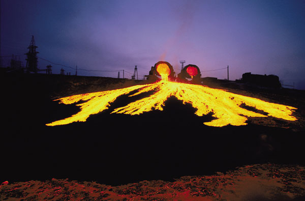 Nickel smelter, Norilsk, Russia This plant spews molten slag; Russia is the world's largest nickel producer. Mining leaves an indelible mark on landscapes and, as one of the most dangerous occupations, on people's lives. Instead of increased mining, we could reuse or make more use of minerals already obtained. Photo: Gerd Ludwig / Panos