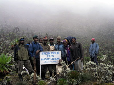 BaKonzo men amid their alpine climate – and the diminishing glacier high up in the Rwenzori Mountains. Photo: Richard Taylor