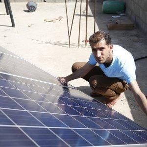 The Gaza electricity crisis: installing solar panels in the Gaza strip.