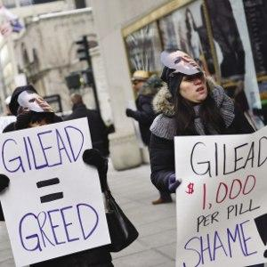 Drug costs: Protesters march against the pricing of Sovaldi in 2014, wearing masks of John C Martin – former CEO now Executive Chairman of Gilead.