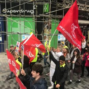 Rev Billy walks with UNITE through the streets of Liverpool