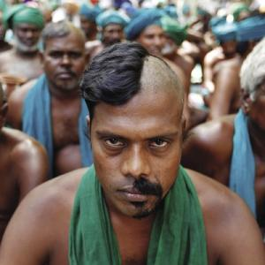 Farmers from the southern state of Tamil Nadu pose half-shaved during a protest to demand a better drought-relief package from the federal government in New Delhi, India.