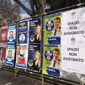 Electoral posters in Via d'Alviano, Milan. From left to right: Liberi e Uguali's ('Free and Equal'), three right-wing posters, and a centrist one.
