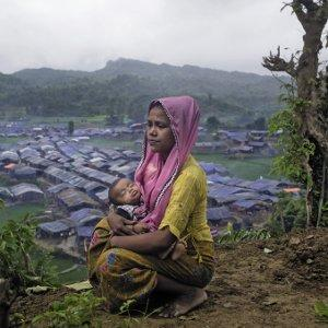 A Rohingya refugee takes a moment's pause, shortly after arriving in a makeshift camp at Teknaf, Bangladesh, last September. She is one of over 670,000 people to have fled over the border from Myanmar since August 2017.