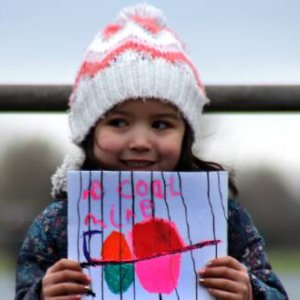 A child demonstrates against the mining industry's claims that the West Cumbria Mine (and others) are carbon neutral. Credit: Coal Action Network