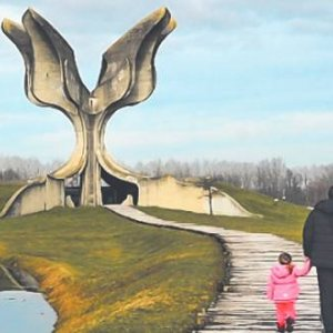 A father and his young daughter visit the Stone Flower monument at Jasenovac. Designed by the famous Serb architect Bogdan Bogdanović, it is a memorial to the victims of Ustasha atrocities during the Second World War. FERDINANDO PIEZZI/ALAMY
