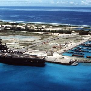 U.S. Navy aircraft carrier USS Saratoga anchored at the Diego Garcia naval base in the 1980s.