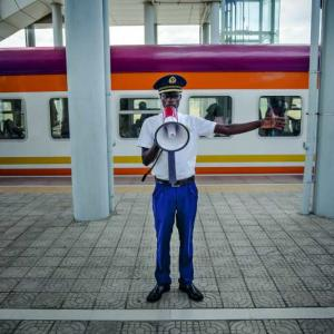 A guard at the Mombasa terminus of the Chinese-financed SGR railway. Saturday is one of the busiest times on the line, as Kenyans travel from Nairobi to the coast to visit family.