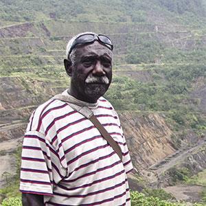 Philip Miriori stands over the gaping wound that is Panguna Mine.