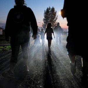 People take part in a smudging ceremony organised by the First Nations Indigenous Warriors and the American Indian Movement on the Cote First Nation, near the town of Kamsack, Saskatchewan, Canada, August 6, 2017. Smudging is a common practice among some indigenous peoples in North America and is believed to cleanse a person or place of negative energy. REUTERS/Zachary Prong