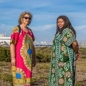 Liz McDaid and Makoma Lekalakaka in front of the country's only nuclear power station – Koeberg.