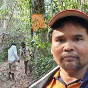 Ouch Leng in Prey Lang Forest, pictured in February 2021, protecting resin trees prior to his arrest.