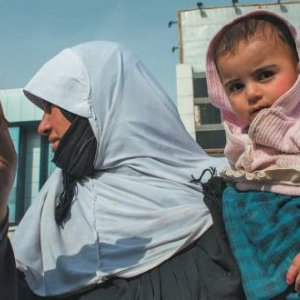 Poverty is not unusualin the oil-rich semi-autonomous region.  This woman begs in Erbil. Ton Koene/Alamy