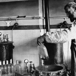 French biochemist Louise Pasteur in his laboratory, where he developed pioneering vaccines against the chicken cholera and rabies using 'attenuated'or weakened bacteria. GL Archive/Alamy