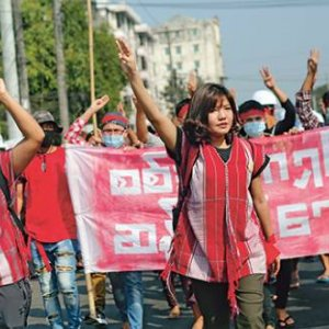Esther Ze Naw and Ei Thinzar  Maung lead the first large-scale protests against  the coup in Yangon, 6 February 2021.  MYAT THU KYAW/NUR PHOTO/GETTY