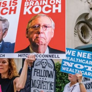 Activists in New York City protest against the influence of 'dark money' from the billionaire Koch brothers on many areas of political decision-making, including healthcare. ERIK MCGREGOR /SIPA USA/PA IMAGES