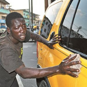 A car cleaner in Monrovia, Liberia. Informal workers have been hardest hit by lockdown measures. TOMMY E TRENCHARD/ALAMY
