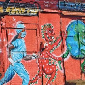 A local art group, art360, painted this mural dedicated to the fight against the virus in the settlement of Kibera, Nairobi, Kenya. GORDWIN ODHIAMBO/AFP/GETTY