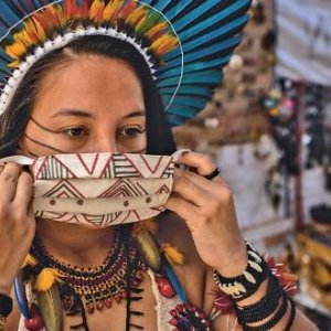 Fighting on all fronts. Samela, a 23-year-old activist from the Association of the Satere-Mawe Indigenous Women in Manaus, Amazonas in Brazil, co-ordinates the production of protective face masks.RAPHAEL ALVES/IMF/CREATIVE COMMONS