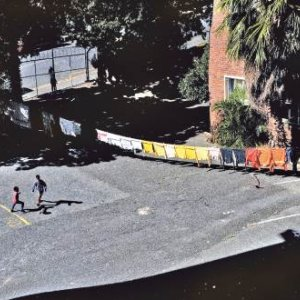 Colour-co-ordinated laundry hanging out to dry in the background, children play in the parking lot of Cissie Gool House, an unused government hospital in the Woodstock neighbourhood, occupied by 700 evictees from the area since 2017.LERATO MADUN