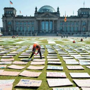 Where we would have been: Fridays for Future activists leave placards outside the Reichstag in Berlin,  Germany, as an alternative climate protest. Kay Nietfeld/DPA/Alamy Live News