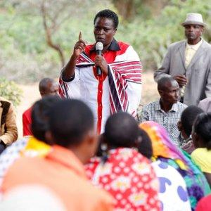 Kenyan lawmaker Sarah Korere talks to supporters during an election campaign rally in the village of Dol Dol in Laikipia County, Kenya.